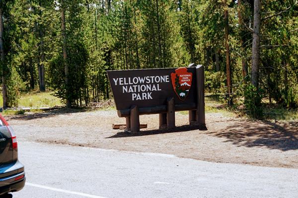 Yellowstone sign at west entrance to park