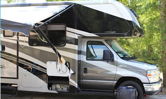 A class C RV with a complete off grid power system installed.