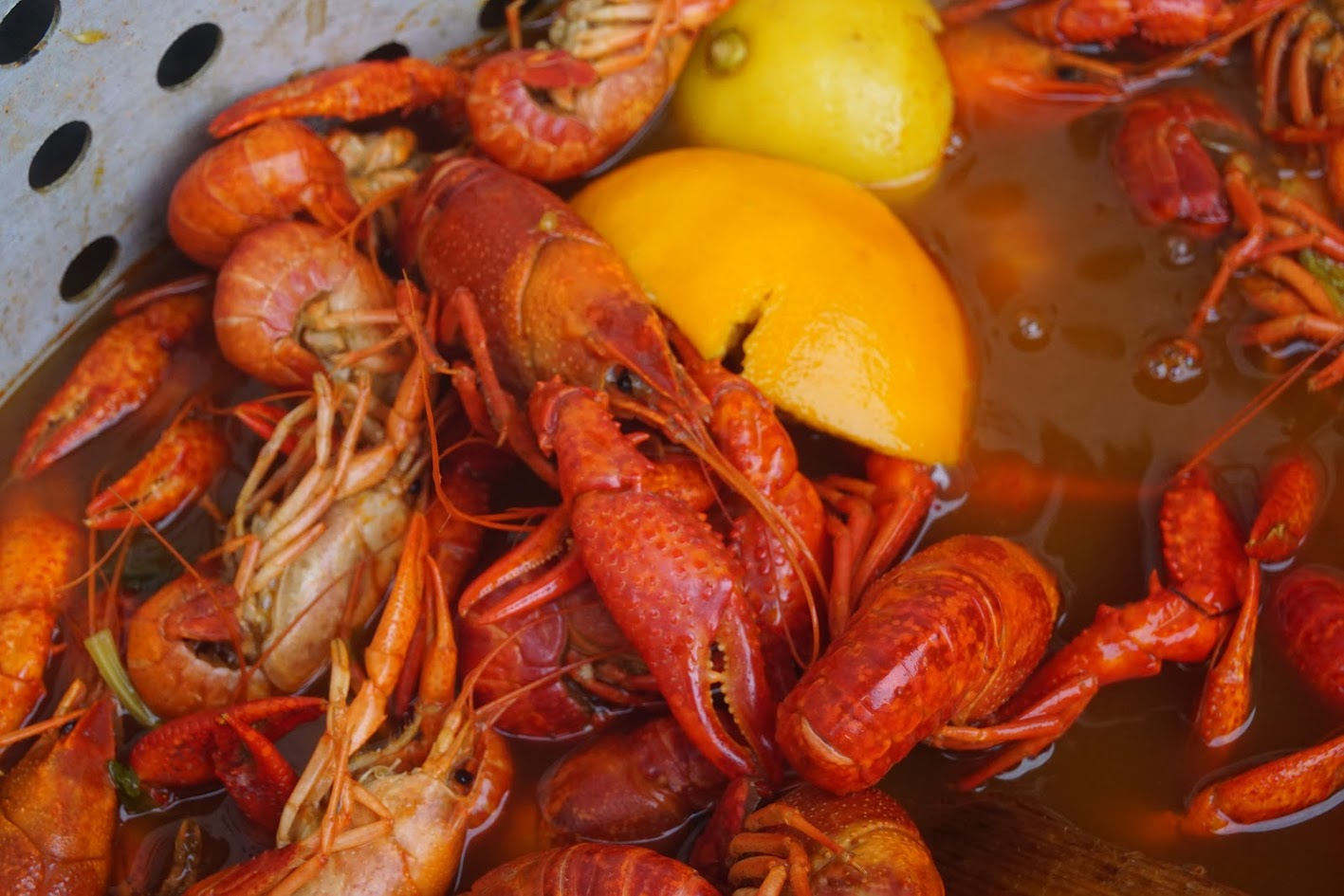 A Crawfish Boil Starts With A Lot Of Seasonings, Fruits, And Vegetables  The Chef Or Artist Cooking The Crawfish Will Bring Their Own Flair To The  Pot