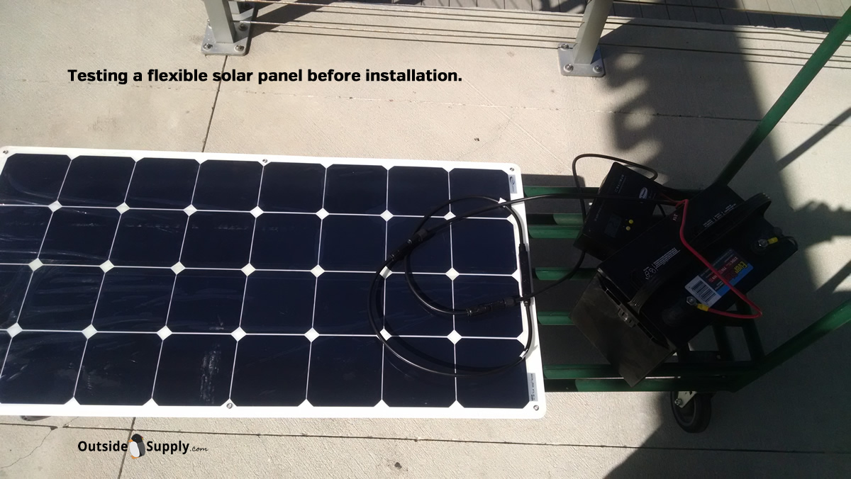 Testing a flexible RV solar panel kit before installation.