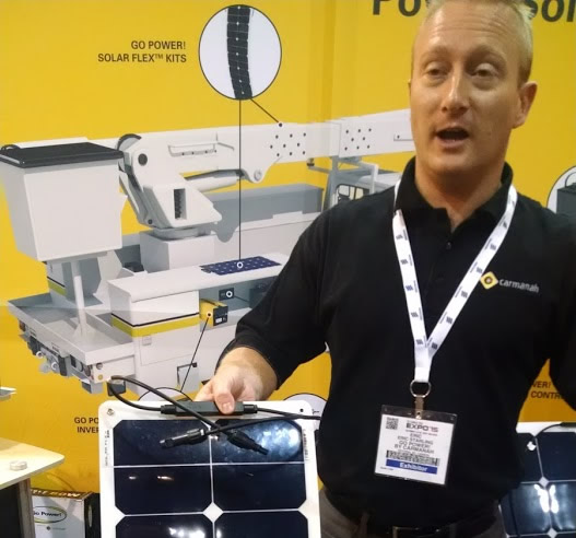 Eric shows 50 watt solar charging panel for lift gates on trucks.